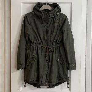 Drop back trench hooded parka